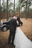 Just married couple in the luxury retro car on their wedding day.  Stock Photography