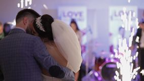 Just married couple making a kiss after first dancing at wedding party stock video