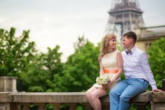 Just married couple near the Eiffel tower Royalty Free Stock Photo