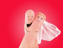 Just married couple - newlyweds painted at fingers Royalty Free Stock Image