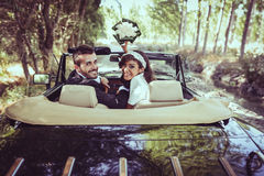Just married couple in an old car Royalty Free Stock Photo