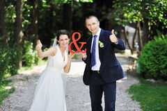 Just married couple - outdoors portrait. Just married couple - outdoor portrait Royalty Free Stock Photo