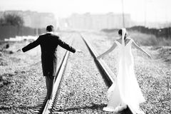 Just married couple on railway Royalty Free Stock Images