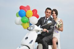 Just married couple ride white scooter Royalty Free Stock Photo
