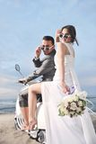 Just Married Couple Ride White Scooter Stock Photos