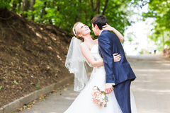 Just married couple running on a park Royalty Free Stock Photo