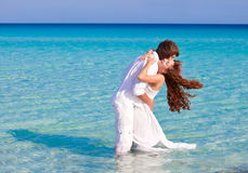 Just married couple in the sea Stock Photos