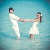 Just married couple in the sea Stock Image