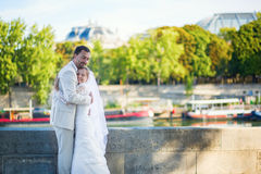 Just married couple on the Seine embankment Royalty Free Stock Photography