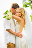 Just married couple sharing intimate moment Stock Photography