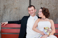Just married couple sit on a bench royalty free stock photography