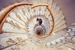 Just married couple in a spiral staircase. Just married couple together in a spiral staircase Royalty Free Stock Photo