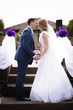 Just married couple standing face to face and kissing Stock Photo