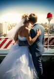 Just married couple standing on the roof and looking at urban ci Royalty Free Stock Images