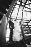 Just married couple standing on stairs under roof Stock Photography