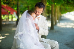 Just married couple in Tuileries garden of Paris Royalty Free Stock Images