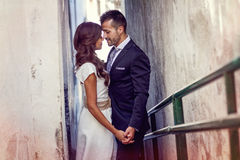 Just married couple in urban background Royalty Free Stock Photo