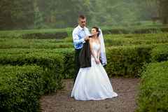 Just married couple walking at garden labyrinth Stock Photography