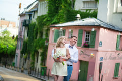Just married couple walking on Montmarte in Paris Stock Image