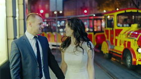 Just married couple walking night city stock video