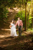 Just married couple walking at park at sunny day Royalty Free Stock Photos
