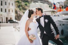 Just married couple walking in small cove Royalty Free Stock Image