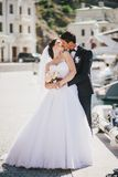 Just married couple walking in small cove Royalty Free Stock Photo