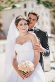 Just married couple walking in small cove Royalty Free Stock Photos