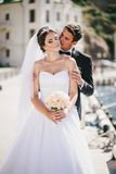 Just married couple walking in small cove Stock Image