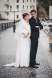 Just married couple walking in small cove Royalty Free Stock Images