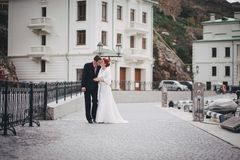 Just married couple walking in small cove Stock Images