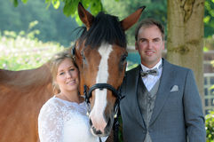 Free Just Married Couple With Horse Royalty Free Stock Images - 57738859
