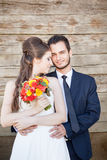 Just married couple on wodden background Stock Image