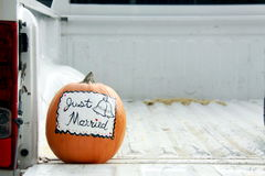 Just Married, Fall wedding. Pumpkin with just married sign painted on it in the bed of a pickup truck Stock Photography