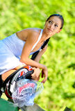 A just married female biker. A beautiful bride, with a motorcycle helmet stock photos
