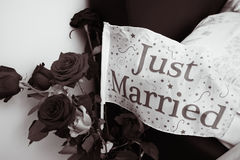Just married. Flag among roses royalty free stock photos
