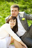 Just married in a flowering garden Stock Photography