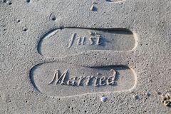 Just Married Foot Prints On Sand stock images