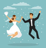 Just married funny couple, bride and groom jumping. From after wedding ceremony Royalty Free Stock Photos