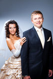 Just married groom and bride on blue Royalty Free Stock Images