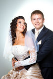 Just married groom and bride on gray Royalty Free Stock Image