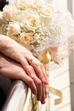 Just married hands. Hands of just married with the wedding rings, bride's one lying over groom's one Stock Photos