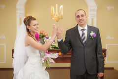 Just married and happy bride and groom Royalty Free Stock Image