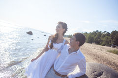 Just married happy bride and groom, young couple. Just married couple running on a sandy beach Royalty Free Stock Photo