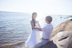 Just married happy bride and groom, young couple. Just married couple running on a sandy beach Royalty Free Stock Images