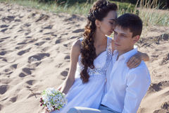 Just married happy bride and groom, young couple. Just married couple running on a sandy beach Royalty Free Stock Image