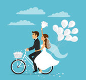 Just married happy couple bride and groom riding bicycle. With balloons Stock Photo