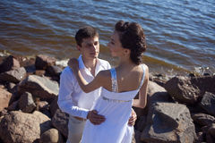 Just married happy couple on a rocky beach Royalty Free Stock Photography
