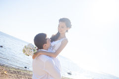 Just married happy couple on a sandy beach. Just married couple running on a sandy beach Royalty Free Stock Photos