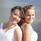Just married happy lesbian couple in white dress close together Royalty Free Stock Photo
